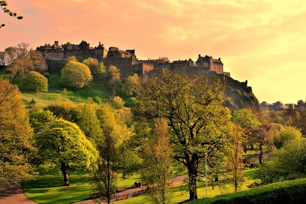 View over gardens up to Edinburgh Castle from Princes Street, Edinburgh.